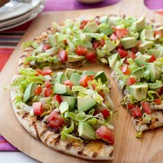 Mexican FIeSTa Pizza...  Thin crust, refried beans, beef or chicken, lettuce, tomatoes, onions, cheese, olives, avocados, cilantro and sour cream.  Cook till crispy and cheese melted.