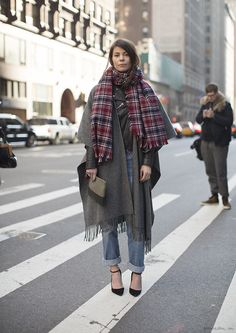 Black leather moto jacket, oversize grey scarf, plaid scarf, heels, boyfriend jeans