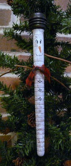 Primitive Christmas Snowman Ornament made with Handpainted Old Wood Bobbins. $15.95, via Etsy.