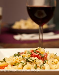 Woman's Spicy Pasta Salad with Smoked Gouda, Tomatoes and Basil ...