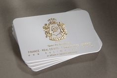 Sujimoto: Crest, printed gold foil and embossed on pristine white 540gsm with round corners.