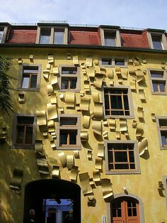 This building is apparently right across the street from the Kunsthofpassage Funnel Wall in Dresden, Germany.