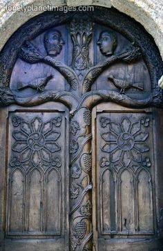 The beautiful wooden door of the ossuary (1667). Lampaul-Guimiliau, Finisterre, Brittany, France, Europe