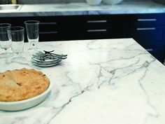 Calacatta marble laminate counter tops. FORMICA !  Until we can afford solid surface/stone.