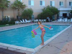 tall kid swimming in hotel pool