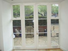 Hardwood Painted White Double Glazed French Doors with 2 framed windows either side  Picture 1