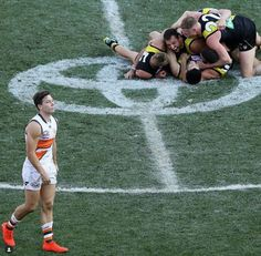 Richmond players celebrating the 2019 Grand Final win, Toby Greene from Greater Western Sydney lamenting the loss. Richmond Football Club, White Boys, Dream Team, Running, Celebrities, Tigers, Sydney, Sports, Fashion