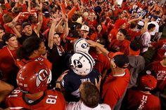 Utah fans swarm the field as Utah defeats BYU after a wild ending, Sept. 15, 2012. (Trent Nelson     The Salt Lake Tribune)