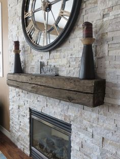 beautiful stone veneer surround for gas fireplace with rustic wood mantel detail by M&V Contractors