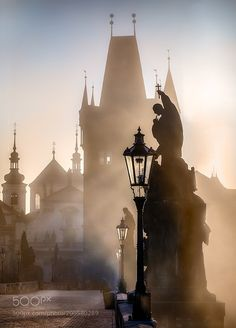 Prague Charles Bridge in the Morning Fog -  Funny story how this picture happened. Early morning about 20 photographers was waiting for first light to appear over the buildings and light up nice fog rolling over the bridge. I was as a new there pushed to the side of the bridge so only possible composition was this one so I took the picture.