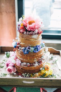 Naked Sponge Cake decorated with Flowers | Warehouse wedding venue in London | City Wedding | Ribbon Decor | Rime Arodaky wedding dress | Bright yellow and orange Colour scheme | Hobbs Bridesmaid dresses | Images by Robbins Photographic | http://www.rockmywedding.co.uk/yvonne-jimmy/