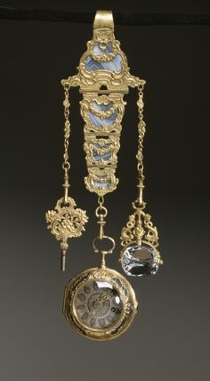 Chatelaine with Watch, 18th c, French, Gold, gilt metal, agate, rock crystal. The watch and chatelaine are decorated with elaborate scrollwork and garlands over beautifully striated agate. The chatelaine is fitted with a watch key and a revolving rock crystal seal, neither of which were likely made at the same time as the chatelaine and watch.