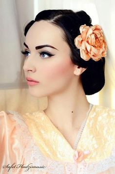 Soft, airbrush glow of a 50's pinup-esque model. This will be my wedding makeup, except I'm going to go for a deeper red lip.