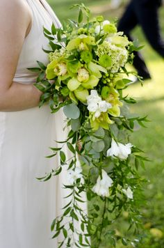 Gorgeous Cascading Wedding Bouquet Which Includes: White Freesia, Lime Green Cymbidium Orchids, Green Hydrangea, Green Silver Dollar Eucalyptus Several Additional Varieties Of Greenery Foliage Bouquet En Cascade, Cascading Wedding Bouquets, Bridal Bouquet Fall, Bridesmaid Bouquet, Floral Wedding, Wedding Flowers, Wedding Dresses, Freesia Bouquet, Lily Bouquet