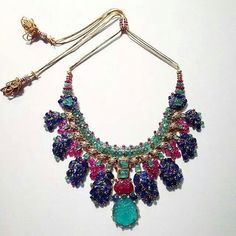 Cartier 'Tutti Frutti' Necklace, c.1938, set with carved emeralds, rubies and sapphires, on loan to the @denverartmuseum from a private collection. Although it's form and materials seem to evoke traditional Indian jewels, it fuses traditional and non-traditional elements into a vividly colored design. , the cords are made of braided gold, rather than silk. The 'tutti-frutti' color palette is itself European, as sapphires are generally considered inauspicious in India.
