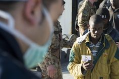 Antonio Parrinello/Reuters ACCOUNTED FOR: A migrant held up his number as he disembarked from a navy ship in Augusta, Italy, Friday. The Italian navy said Thursday it had rescued more than 1,000 migrants off the coast of Lampedusa island.