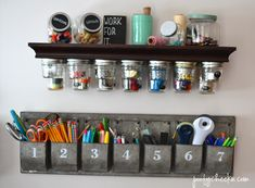 Attach magnets or a magnetic strip underneath a shelf and use jars with metal lids to display items.