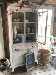 Country Grey and Pure White transformed this cabinet! Chalk Paint® decorative paint by Annie Sloan is life changing! So easy to use!! www.twooldbirds.com #twooldbirds #raleigh #apex #vintage #chalkpaint #anniesloanstockist