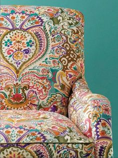 Bohemian chair, turquoise wall....gorgeous!