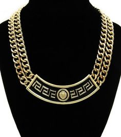 This cute necklace has blended the lion head and Greek Key symbol together!