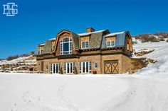 Robert G Sinclair - Architect - Aspen - American Country - Cottage - Rustic - Home Exterior - Cozy - Neutrals - Exposed Brick - Large Windows - Double Doors - Glass Panels - Wood - Snow - Views - Architecture