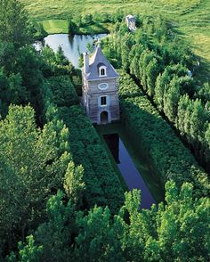 The towering folly named the Pigeonnier at the garden created by Frank Cabot at his Quebec family estate, Les Quatre Vents.