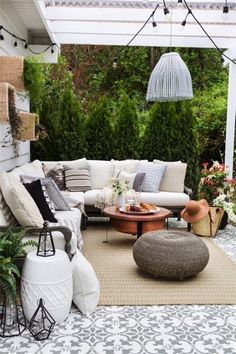 Outdoor tile, rug, poufs, and pillows