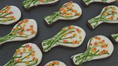 These pretty biscuits are flavoured with orange zest and cocoa.   For this recipe you will need a template to cut out the biscuits (see tip) or a 6cm/2½in round biscuit cutter, 5 piping bags fitted with small plain nozzles and an electric mixer.