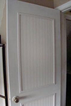 Cheap and easy makeover for boring doors with beadboard wallpaper!use real beadboard and trim! Hollow Core Doors, Cheap Doors, Up House, Kitchen Cupboards, Diy Kitchen, Home Projects, Home Remodeling, Just In Case, Diy Furniture