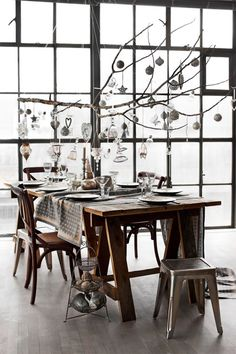 Christmas decor: natural feel to any room with the cut tree branch and silver, white and natural fiber ornaments..LOVE IT!