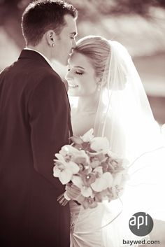 Love how the photographer caught this romantic moment at the wedding.