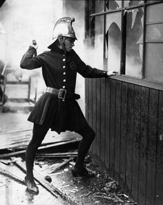 1926, A member of the Achille Serre Ladies Fire Brigade in London.
