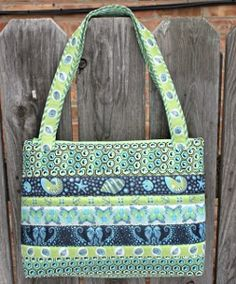 Save some bucks and live in style when you carry this Vera Bradley Knock-Off Bag.