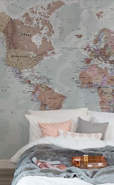 Sleepy Sundays in these beautiful pink and neutral hues. This world map wallpaper encompasses a wonderful array of cool and muted colours. Pair with layers of different textures for a truly cosy feel in the bedroom.