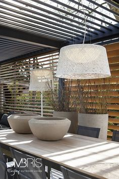For more traditional design a single suspended light can be installed into the Umbris roof installation, perfect for use of an external dining area | Lighting Options | UmbrisbyIQ |