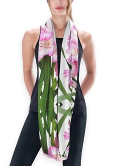 Pink Iris Eco Infinity Scarf: What a beautiful product! Our Eco Infinity Scarf made from 96% recycled materials features a classic shape and transforms with easy twists and turns. Wear it long or double it up for a cosier feel.