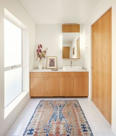 """One key to sustainability and happiness is """"stripping away elements of excess to create simple, livable, and well-lit spaces that feel larger than they are."""""""