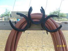 Horse shoe hose rack