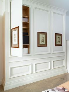 Love these hidden cabinets - Could do something like this to hide TV in bedroom also