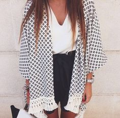 Kimono with a little fringe detail.