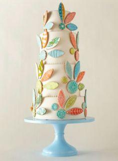 White cake with turquoise, green, orange decoration #laylagrayce #weddings