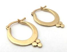 The inspiration for these earrings came from my beloved India. These dainty hoop earrings are made from 14k yellow gold and have three tiny gold dots that gives them the unique Ethnic look. #studiouunkiya