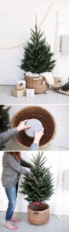 DIY Christmas Tree Stand Using Bucket Upside Down In A Large Basket. #decoratingachristmastree #christmastips