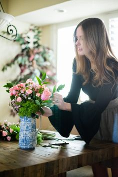 Miss USA 2011 Alyssa Campanella of The A List blog with Bouquet Bar's luxury Valentine's Day gift box in BCBG MAXAZRIA Bell Sleeve Sweater and Club Monaco Jouiette Skirt