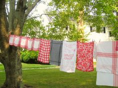 dish towels hanging on the line--so pretty and nostalgic looking!!