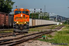 https://flic.kr/p/22df1we | BNSF 5820 | GE ES44AC | NS Memphis District | BNSF loaded coal train C-BAMMHS0-13A moves onto the east main of the NS Memphis District at Tower 17. The train will transfer to the NS and become the 736.