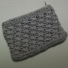This free crochet pattern is for a cross-over long dc pouch. You can use it as a wallet or small makeup bag.