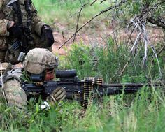 A U.S. Army soldier scans an area through his M240L machine gun's scope for intruders while on security during a platoon live-fire exercise. Army Soldier, Rifle Scope, Fire, Exercise, Ejercicio, Excercise, Work Outs, Workout, Sport