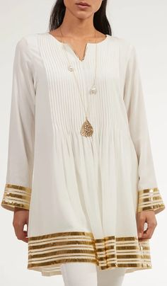 Sultana Gold Embellished Long Modest Tunic - Off White - Stylish Off White and Gold Embellished Long Modest Tunic. Save on fashionably modest Islamic and Muslim Clothing and Hijab fashion at Artizara. Source by artizara - Stylish Dress Designs, Stylish Dresses, Nice Dresses, Casual Dresses, Simple Pakistani Dresses, Pakistani Dress Design, Pakistani Bridal, Hijab Fashion, Fashion Outfits