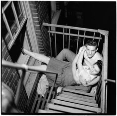 Park Benches - Love is Everywhere [Couple flirting on a fire escape], 1946, by Stanley Kubrick. More can be seen at the Museum of the City of New York.